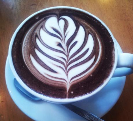 Latte Art in Lyme Regis Amid Giants and Idols