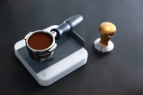 espresso dose on scale and tamper